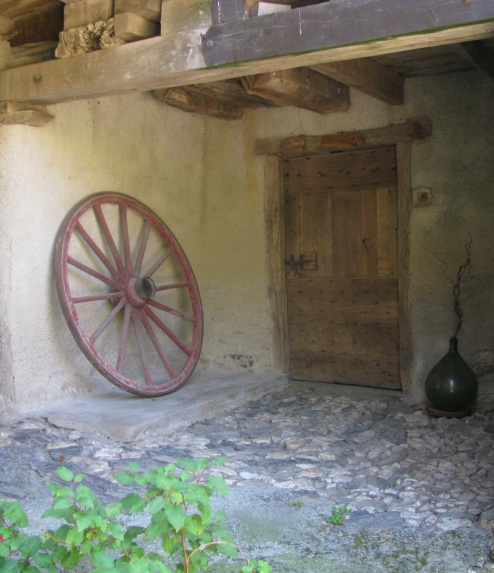 Old wheel and door